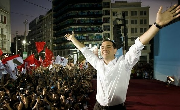 Head of Syriza, Alexis Tsipras waves after winning the elections in Athens