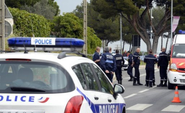 A file photo shows French police officers standing at the site of a crime. AFP