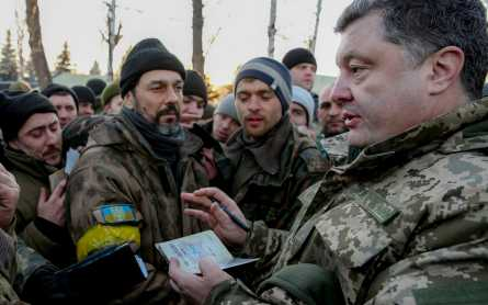 Petro Oleksiyovych Poroshenko, the fifth and current President of Ukraine, talks to troops